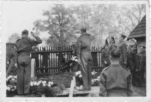 At a funeral in Ehrenforst, Dad is saluting on the right.